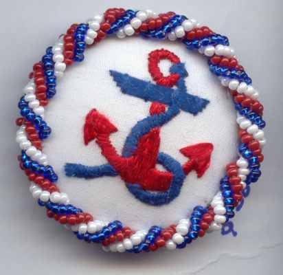 embroidered anchor in red, white and blue, with beaded border