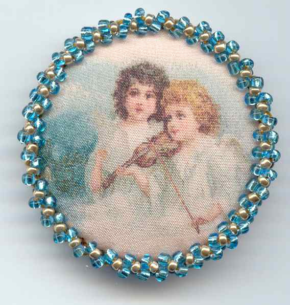 2 Angels printed on silk, one playing the violin, beaded border.