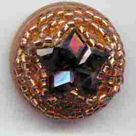 beaded Vegetable Ivory button with faceted garnet star