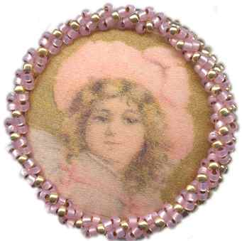 Girls head in pink with hat, beaded 1&1/4