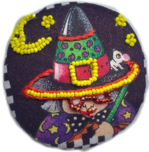 Mary Englebreit witch embellished with beads and floss
