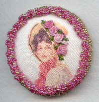 Lady printed on silk with bullion stitch roses and beaded border