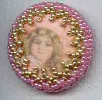 printed silk button with decorative beaded border in pink and gold