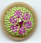 Beaded pink flower green background on VI base